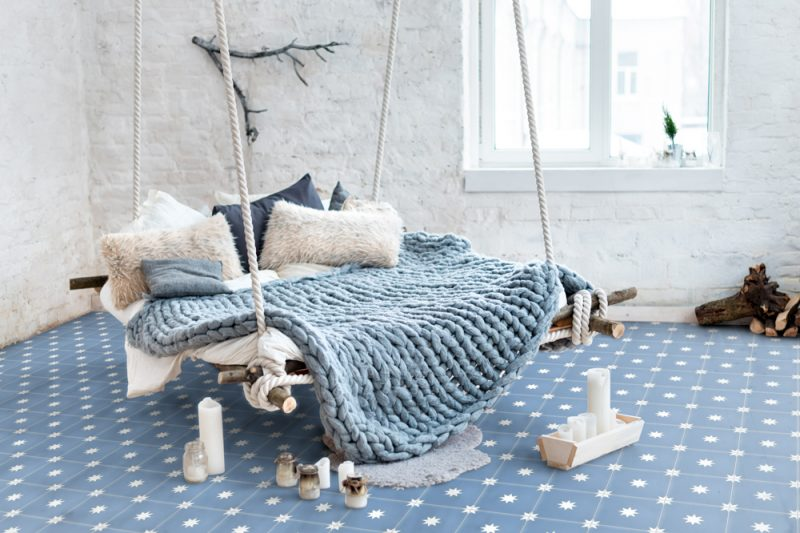White loft interior in classic scandinavian style. Hanging bed suspended